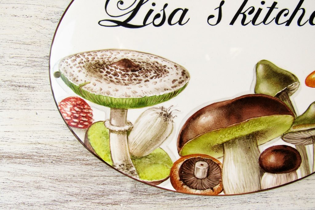 detail of hand painted mushroom kitchen sign