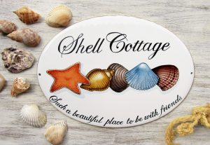 Custom porcelain house sign with shell decoration