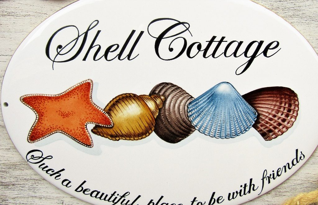 custom hand painted house sign with shell decoration