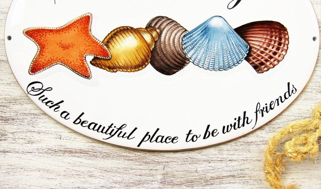 Shell decoration on custom porcelain house sign