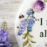 detail of bumblebee over flowers on custom garden sign