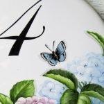butterfly detail on hydrangea address plaque