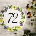 hand painted porcelain round sign with violets