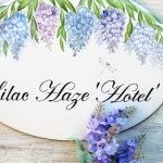 detail of personalized house sign with wisteria branches