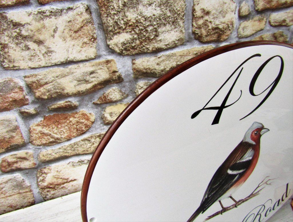 Detail of painted edge on chaffinch house address sign
