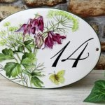 Hand painted personalized house number with floral decoration