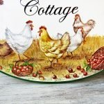 detail of rustic country scene on porcelain house sign