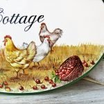detail of personalized rustic countru cottage sign